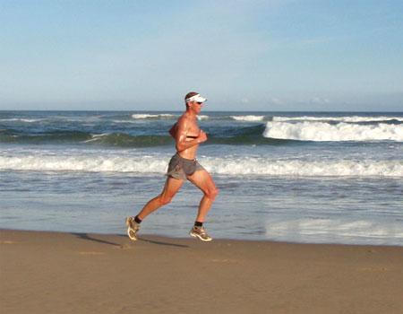 Conrad Stoltz running on the beach