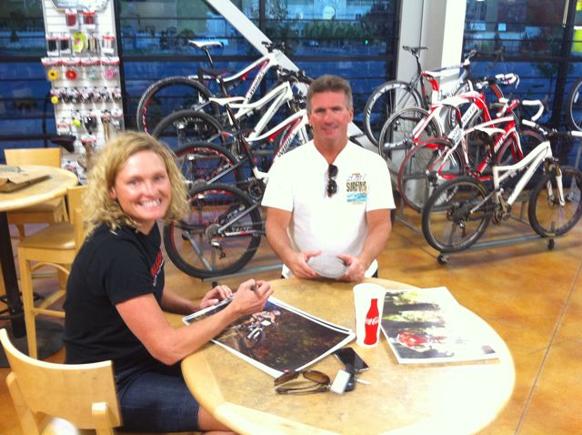 bingham-cyclery-signing-posters-with-melanie-mcquaid
