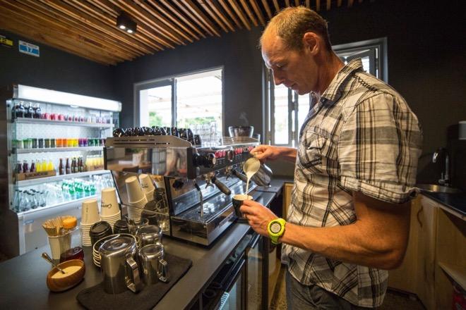 Caveman Conrad Stoltz pouring flat whites atCaveman Cafe